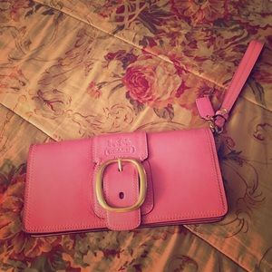 Coach pink wristlet with gold buckle
